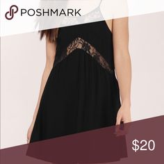 Darkest Fantasy Shift Dress Sleeveless strappy shift dress with flowy hemline and wrap around lace inset and matching front trim. Brand new, tags still on. Tobi Dresses Midi