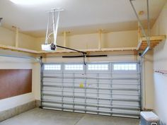 Our Big Shelf - Custom Garage Overhead Storage Installation . We did this with our garage with kayak storage over the cars on a pully system. Garage House, Garage Shed, Garage Tools, Car Garage, Garage Plans, Garage Shoe Storage, Garage Bench, Garage Workbench, Garage Atelier