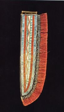 Great Lakes quilled hide knife sheath, probably Huron, that is 9 inches long & finely decorated in ivory, orange & blue porcupine quillwork with an edge trimmed with tiny tin cone pendants inserted with red-dyed deer fur.