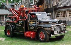 Beautiful Ford with Holmes booms. One sharp old wrecker.