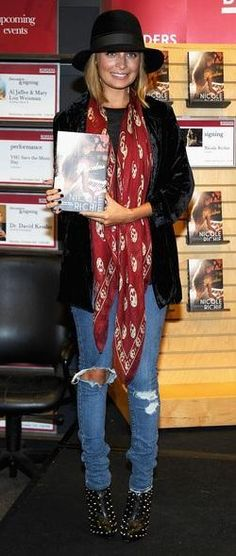 Who made Nicole Richie's black studded boots, red scarf, and ripped jeans that she wore at Borders Books & Music, Columbus Circle on September 28, 2010 in New York City? Jeans – JET  Shoes – Christian Louboutin  Scarf – Alexander McQueen
