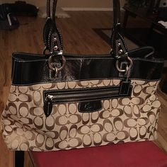 Couch purse Nice size bag. Barely used. Width is perfect for a folder/notebook or an iPad. Had zipper divider perfect for makeup. Inside zip pocket and outside zip pocket. Coach Bags Shoulder Bags