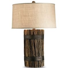 "Rustic Wood and Iron Lamp The based is made with reclaimed wood and wrapped in aged bronze iron. The shade is made from a light putty-shade of burlap. • Takes one 150-watt light bulb H:33"" W:22"""