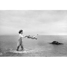 Jacqueline Kennedy swinging Caroline in surf, Hyannis Port, 1959. By Mark Shaw.