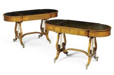 A MATCHED PAIR OF REGENCY ROSEWOOD GAMES TABLES  CIRCA 1815 attributed to Gillows of Lancaster, each with applied gilt-brass mounts and with tooled leather inset tops, the centre section with a chequer games board to reversible above a velvet back gammon board in one table and a leather back gammon board to the other, each with a frieze drawer and twin D-shaped end compartments with hinged flaps, on lyre end supports, with sabre legs and brass capping and castors