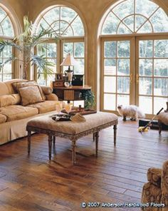 Gorgeous Sunroom - love the french doors with palladian windows