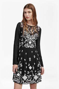 <ul> <li> Floral-embroidered fit and flare dress in semi-sheer chiffon</li> <li> Round neck</li> <li> Long sleeves</li> <li> Bandeau underlay at lining</li> <li> Pleating at skirt</li> <li> Back zip fastening</li> <li> Fit and flare fit — fits the waist closely and flares freely over the hips</li> <li> UK size 10 centre-back length is 86cm</li> <...