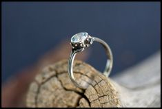 Blue topaz engagement ring: Alternative by AnniamAeDesigns on Etsy