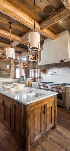 photos of rustic log home kitchens   Pearson Design Group   Big Sky Residence   Cabin Kitchen & Dining
