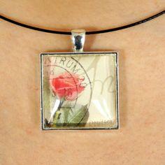 Magnifique pendentif fait avec un timbre-poste oblitéré by PetiteMeduse on Etsy