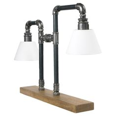 The perfect complement to your industrial scheme, this stunning desk lamp is crafted from steel piping and features a wooden base. Team with an upcycled wood...