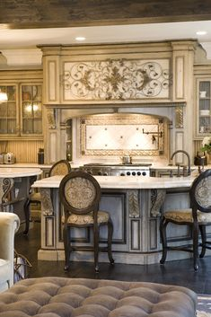 Key focal point: The hand painted Venetian Hearth range hood.