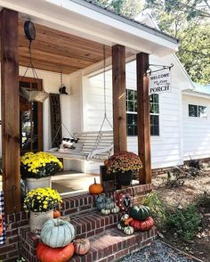 """7,455 Likes, 37 Comments - Better Homes & Gardens (@betterhomesandgardens) on Instagram: """"Our porch dreams have come true, thanks to @2561farmhouse The mums tie into the color palette of…"""""""