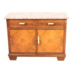 Vintage 1950s Art Deco buffet with a marble top and bakelite hardware.  Product: BuffetConstruction Material: Oa...