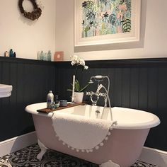 Black panelling in this bathroom compliments the tiles floor perfectly and the pink bath adds some colour. Love the Lucy Tiffney framed print as well. Bathroom Niche, Bathroom Paneling, Bathroom Rules, Modern Bathroom, Small Bathroom, Bathroom Black, Family Bathroom, Bathroom Renovations, Bathroom Interior