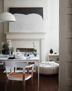 """Carry theme into adjoining """"cocktail space"""" with revised fireplace mantle.  i like the mantle"""
