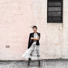 Margaret Zhang from Shine by Three wears Riot Eyelet Bell Dress.