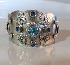 Sterling silver, Sky Blue Topaz and Blue Zircon accent stones. http://www.sarasangerdesigns.com