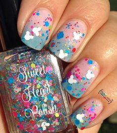 Disney World or Bust is a custom blended artisan nail polish. It is a mix of neon glitter with white mouse heads and rainbow shimmer in a clear