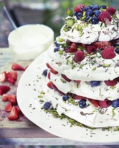 Need a show-stopping summer dessert? We think Alice Hart's Meringue stack with summer berries and vanilla ice cream will do the trick, served here on a beautiful platter by Brickett Davda | Styling Lucy Attwater | Photograph Emma Lee | Homes & Gardens | http://www.hglivingbeautifully.com/2015/05/06/a-summer-feast-in-the-forest/