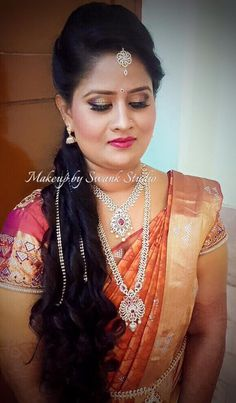 Traditional Southern Indian bride, Sumathi wears bridal silk saree and jewellery for her reception. Makeup and hairstyle by Swank Studio. Red lips. Glitter eye makeup. Bridal jewelry. Bridal hair. Silk sari. Bridal Saree Blouse Design. Indian Bridal Makeup. Indian Bride. Gold Jewellery. Statement Blouse. Tamil bride. Telugu bride. Kannada bride. Hindu bride. Malayalee bride. Find us at https://www.facebook.com/SwankStudioBangalore