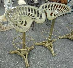 Antique tractor seats as bar stools
