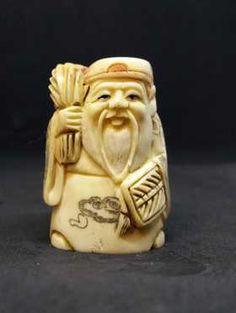 Vintage okimono hand carved cattle bone netsuke, man