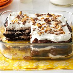 """Double-Chocolate Toffee Icebox Cake Recipe -My mother-in-law gave me a cooking lesson when I first got married: """"Anything tastes good if you put enough butter, chocolate or cream in it."""" This cake has two out of three and proves she was right. Sometimes I use chocolate graham crackers and stack up the layers in a 9x9 pan. —Bee Engelhart, Bloomfield Township, Michigan"""