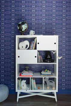 A little boy's Star Wars themed bookshelf
