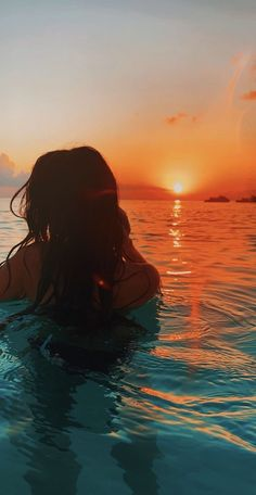 A girl is photographt in the ocean with the orange yellow-ish sunset behind her. You can still see a bit blue color of the actual ocean at the front of the picture, but it fades into the orange color of the sunset. Summer Pictures, Beach Pictures, Summertime Pictures, Insta Pictures, Vacation Pictures, Summer Vibes, Summer Sky, Summer Nights, Summer Beach