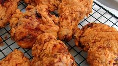 "While it may not be traditional for ""Southern"" fried chicken, I love the tangy tenderization that the buttermilk provides. After the buttermilk soak, dredge the chicken pieces in seasoned flour, and fry them in hot oil until crisp and golden."