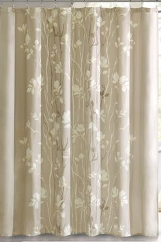 Features:  -Pattern: Floral.  -Material: Polyester.  -Color: Taupe.  -Machine wash cold, Gentle cycle and separately.  -Do not Bleach.  -Tumble dry low, Remove promptly.  Product Type: -Shower curtain