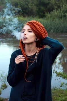 So beautiful! I want my dreads to be as skinny and beautiful as hers. I'm even loving her red dreads but mine will definitely be blonde :)
