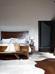 pine floors + hide rugs