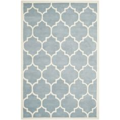 Update your home decor with this modern-themed Moroccan blue wool area rug. This high-quality item was handmade and features a half-inch of pile. The geometric design makes the rug enjoyable to look at, and the pile height gives it a soft feel.