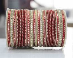 Shimmering Golden And Red Textured Bangles By Leshya Bangles on Shimply.com