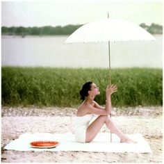 Photograph, from 1954, via Conde Nast Digital Archive.From Glamour, July, 1954. Photo Frances Mclaughlin-Gill