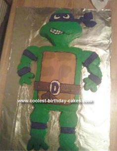 Homemade Donatello Birthday Cake: My son wanted the 'purple turtle with the big stick' for his birthday cake. So, my quest to make a Donatello Birthday Cake came to be. We baked a 13x9,