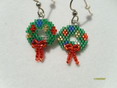 My own original pattern design made with Delica beads. I used brick stitch to create them. The bow is raised. It adds depth to the wreath and lets them stand out above other wreath earrings. This design has always been well received around the holidays and makes a great gift for yourself or someone else! They are 1 and 1/2 inches from the top of the hook to the bottom of the bow. They are on sterling silver french hooks and come with rubber stoppers.