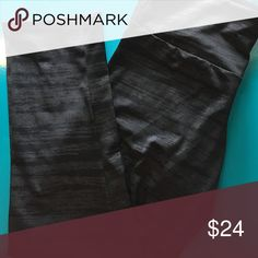 Onzie Tiger Stripe Capri Wide elastic waistband sits low on hips. Slit fit. Black on black. Stripes are a silvery glitter sheen. Triangular-shaped gusset increases your range of motion. 82% polyester, 18% spandex. Lining: 100% polyester. Machine wash cold, hang dry. Made in the U.S.A. and Imported. Onzie Pants Leggings