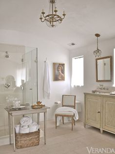 Guest Bath - So agree with design firm, Giannetti Home - Use of chandeliers and sconces instead of recessed lighting. When unable to find the right antique they recommend fixtures from Circa Lighting.