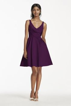 This shortsatin tank dress is perfect for acontemporary chic bridal party look!  Tank bodice features a sultry deep V-neckline and soft satin pleats.  Alluring V-back takes this dress to the next level.  Dress complete with pockets to hold all your bridesmaid essentials!  Fully lined. Imported polyester. Back zipper. Dry clean only.  Sizes and colors are available in limited stores and with limited availability.
