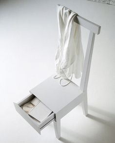 Last week we were pondering bedside table alternatives, among them the very simple solution of placing a chair beside the bed. A chair provides a flat surface and even a place to hang a robe or extra blanket; the only thing it's missing is a drawer for clutter control and privacy. Fortunately, chairs with drawers, if somewhat rare, aren't totally unheard of. Here are a few, along with some tips for searching for more if you like the look...