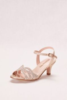1ddce3d82e6 The interlocking knot pattern on the toe of these low-heel sandals is  complemented by