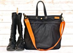 Hey, I found this really awesome Etsy listing at https://www.etsy.com/listing/197820378/black-waxed-canvas-messenger-bag-tote