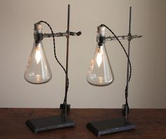 Two matching industrial lamps made from reclaimed laboratory equipment: vintage cast-iron lab stands, Kimax Erlenmeyer flasks and lab clamps.