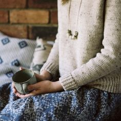 An ex of mine had a sweater just like this. It looked terrible on me but I borrowed it all the time and rolled the sleeves too. Oatmeal, not my color; image, super evocative.