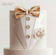 Wedding Cakes by De La Crème Creative Studio ~ Groom's cake is an all white tux with satin-faced lapels, gold bow tie and buttons with boutonniere with gold leaf centers. Pretty Cakes, Cute Cakes, Beautiful Cakes, Amazing Cakes, Fondant Cakes, Cupcake Cakes, Tuxedo Cake, Cakes For Men, Specialty Cakes