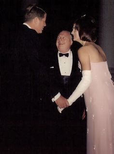 The President: Scene from Camelot - During a formal White House dinner, an enchanted guest chats with the President and First Lady, who are now widely considered the most glamorous couple in the world.