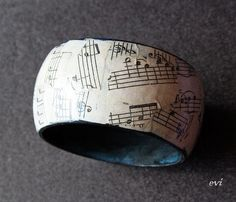 Decoed braclet with sheet music